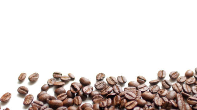 Coffee Beans on white table background with white space , dolly shot left to right video
