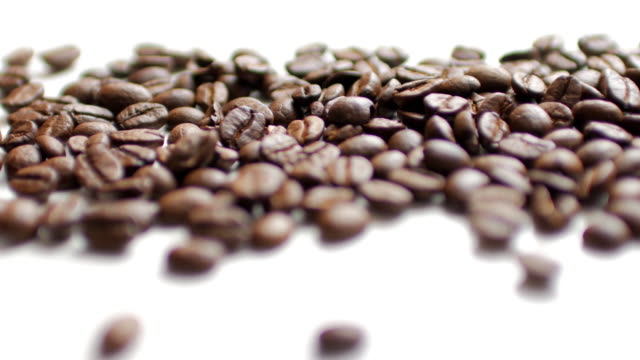 Coffee Beans on white table background with white space , dolly shot right to left video