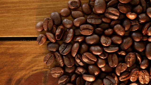Coffee beans on wooden table video