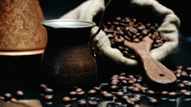 Coffee beans over black video