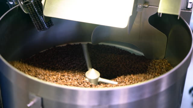 Coffee beans spinning in a cooling drum video