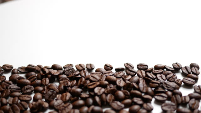 Coffee beans with white background video