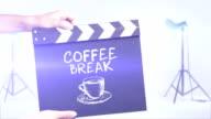 Coffee break film slate in a studio shot background video