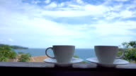 Coffee cup with outdoor view video