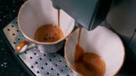 Coffee Machine Making Espresso into a Two Cap video