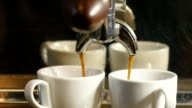 Coffee machine pouring espresso into the cup in slowmotion video