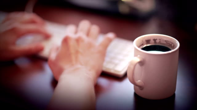 Coffee mug on the wooden desk video