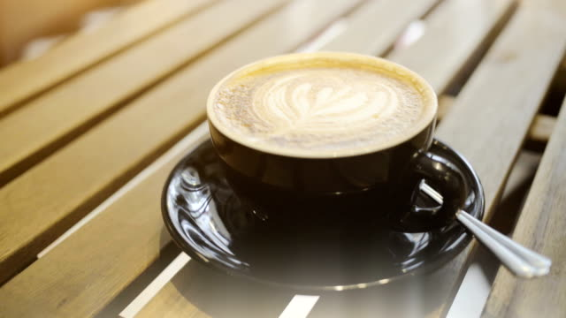 Coffee on wooden table. video