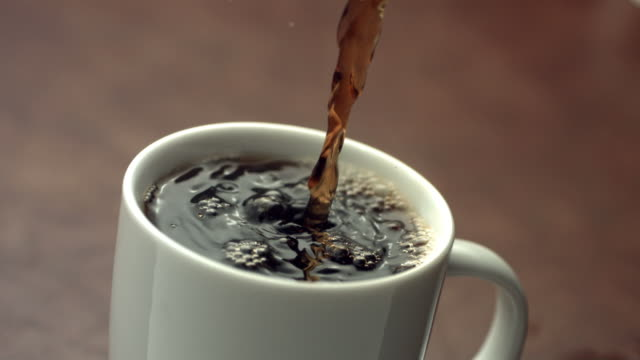 Coffee pouring, slow motion video