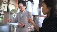 Coffee roasters sorting through freshly roasted beans video