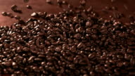 Coffeebeans falling into pile, slow motion video