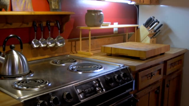 Coil electric range, knives, stainless steel teapot and measuring spoons video