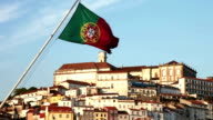 Coimbra old town and Portugal flag seen from the river video