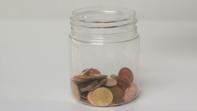 Coin falling into jar. video
