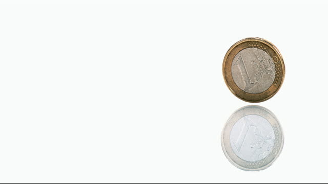 Coin of 1 Euro Rolling against White Background, Slow motion 4K video