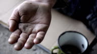 HD SLOW-MOTION: Coin On A Homeless Person's Palm video