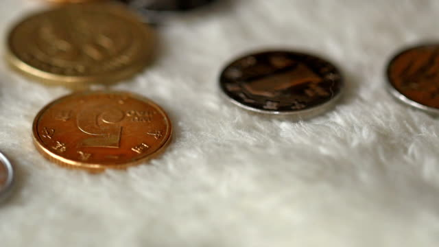 Coins Rolling Out On Woollen Blanket video