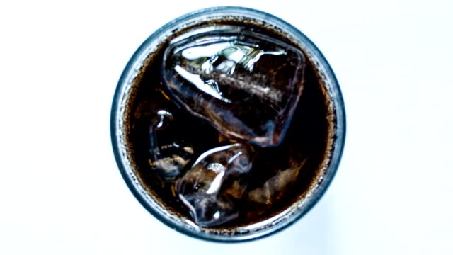 Cola with ice in glass. video