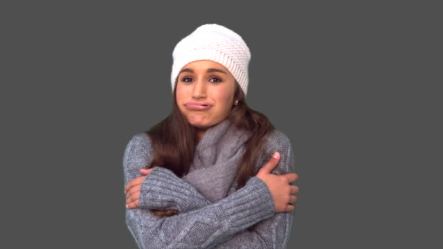 Cold casual young woman shivering video