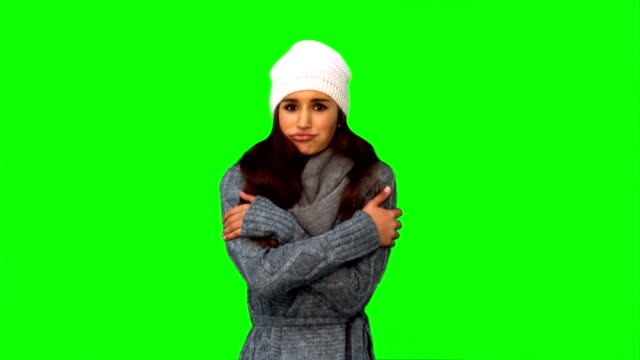 Cold young woman shivering video