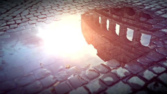 Coliseum reflected in rain water video