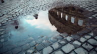 Coliseum reflected in rain water video