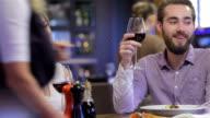 Collaborative romantic dinner in a restaurant video