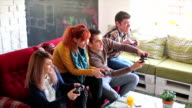 Colleagues playing video games in the office relax room video