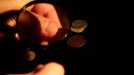 Collector Examines Old Coins video