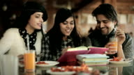 College student friends learning and teaching together in a restaurant. video