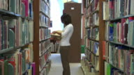 College student in library video