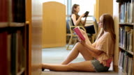 College Student Reads in Library WS video
