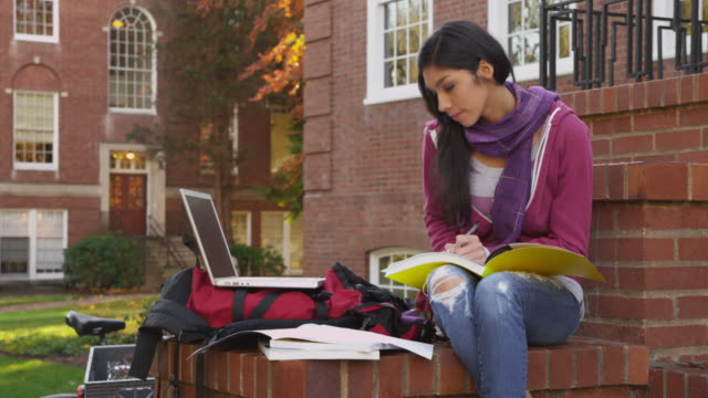 College student studying outdoors video