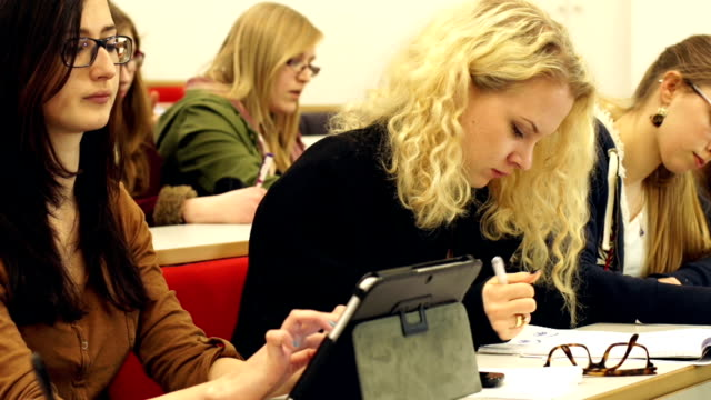 DOLLY HD, College Student using Digital Tablet in lecture hall video