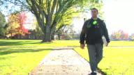College student walking down sidewalk video