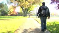 College student walking on sidewalk video