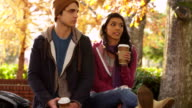 College students hanging out in fall video