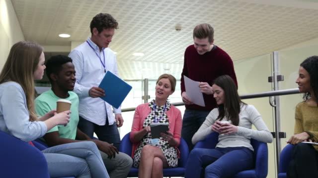College Students Having Informal Meeting With Tutors video