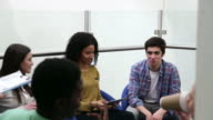 College Students In Seating Area Having Discussion video