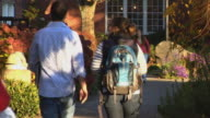 College students walking on campus video