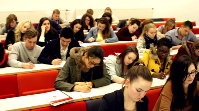 HD CRANE: College Students writing in University lecture Hall video