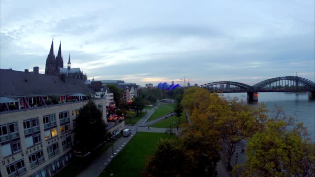 Cologne evening aerial view, ascending near Koln Dom Rhein river. Beautiful aerial shot above Europe, culture and landscapes, camera pan dolly in the air. Drone flying above European land. Traveling sightseeing, tourist views of Germany. video