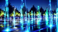 Color fountain in the park at night video