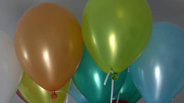 Color helium balloons close up. video