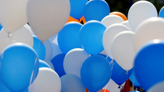 Color helium balloons video