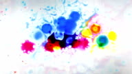 Color Ink drops and splatters on white background video