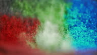 SLO MO color pigments lifted into air by vibration video