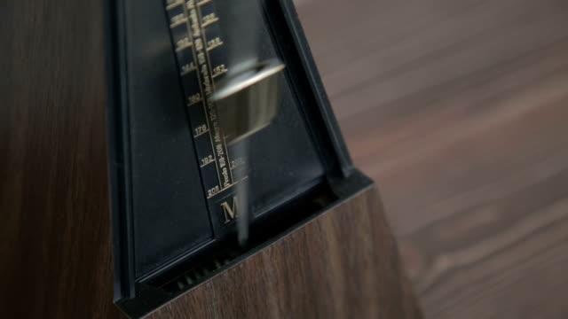Color shot of a vintage metronome video