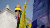 Colored flags fly near Boudha stupa in Nepal video