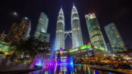 colored night light famous towers fountain 4k time lapse from kuala lumpur video